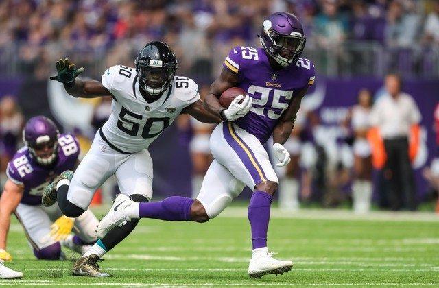 Minnesota Vikings running back Latavius Murray carries the ball past Jacksonville Jaguars linebacker Telvin Smith during the first quarter. (Brace Hemmelgarn/USA Today Sports)