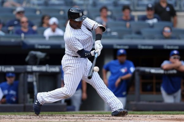 New York Yankees third baseman Miguel Andujar hits a two run double against the Toronto Blue Jays during the third inning.