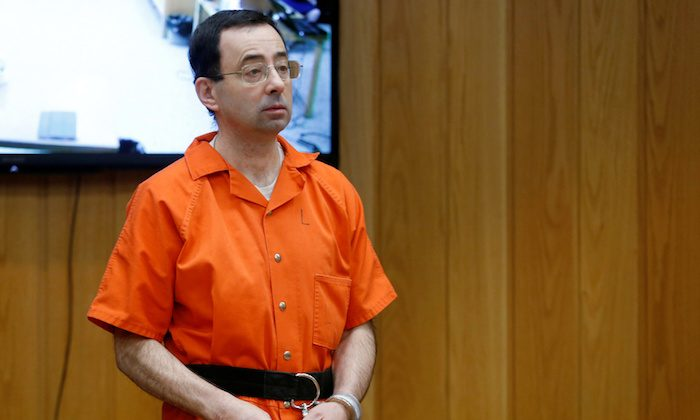 Larry Nassar, a former team USA Gymnastics doctor who pleaded guilty in November 2017 to sexual assault charges, stands in court during his sentencing hearing in the Eaton County Court in Charlotte, Michigan, on Feb. 5, 2018.  (Reuters/Rebecca Cook)