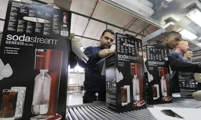 Employees pack boxes of the SodaStream product at the factory in the West Bank Jewish settlement of Maale Adumim. (Reuters/Ammar Awad)