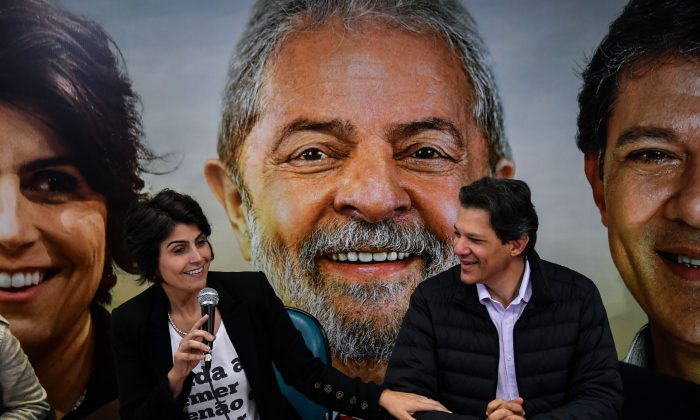 Manuela D'Avila (L), of Brazil's Communist Party (PCdoB), and former Sao Paulo's Mayor Fernando Haddad (R), of the Workers Party (PT), attend a press conference, in Sao Paulo, Brazil, on August 7, 2018. - D'Avila withdrew her presidential candidacy for the Brazilian Communist Party (PCdoB) to become candidate to vice-president in an alliance with the Workers' Party. (Photo by NELSON ALMEIDA / AFP)        (Photo credit should read NELSON ALMEIDA/AFP/Getty Images)