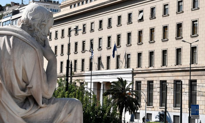 "A statue of ancient greek philosopher Socrates faces the headquarters of the Bank of Greece, in Athens, on August 20, 2018.  Greece emerged on Augsut 20, 2018 from its third and last bailout, although officials warn the country still has a ""long way to go"". (Louisa Gouliamaki/AFP/Getty Images)"