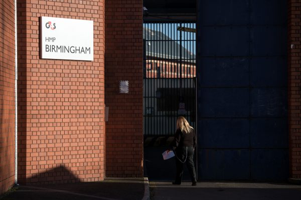 A member of prison staff arrives at HMP Birmingham, central England on December 17, 2016. Staff were found asleep and locking themselves away from prisoners during an inspection in August 2018 that resulted in the running of the G4S facility being taken over by the government. (Oli Scarff/AFP/Getty Images)