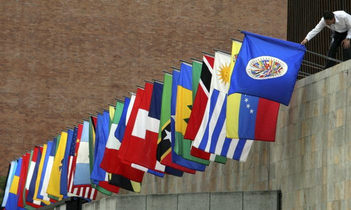 A worker prepares the flags of the Organization of American States (OAS) in Medellin, Colombia in this file photo. (RAUL ARBOLEDA/AFP/Getty Images)