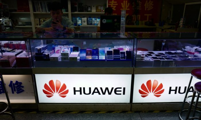 The Huawei logo is seen in a shop in Shanghai, on May 3, 2018. (Johannes Eisele/AFP/Getty Images)