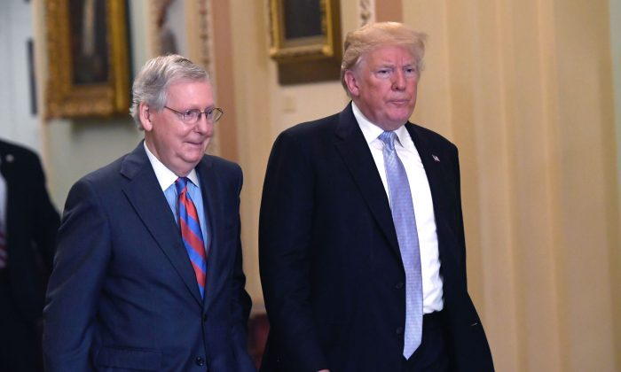 US President Donald Trump and US Senate Majority Leader Mitch McConnell make their way to a Senate Republican policy lunch at the US Capitol in Washington, DC on May 15, 2018. (SAUL LOEB/AFP/Getty Images)