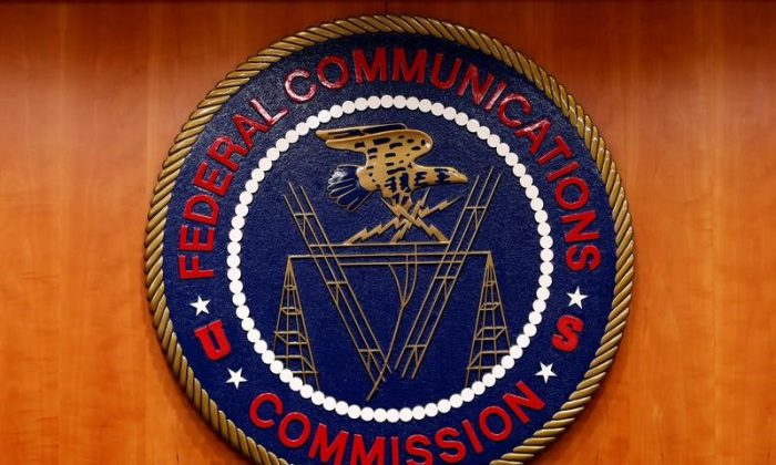 The Federal Communications Commission (FCC) logo is seen before the FCC Net Neutrality hearing in Washington Feb. 26, 2015. (Yuri Gripas/File Photo)