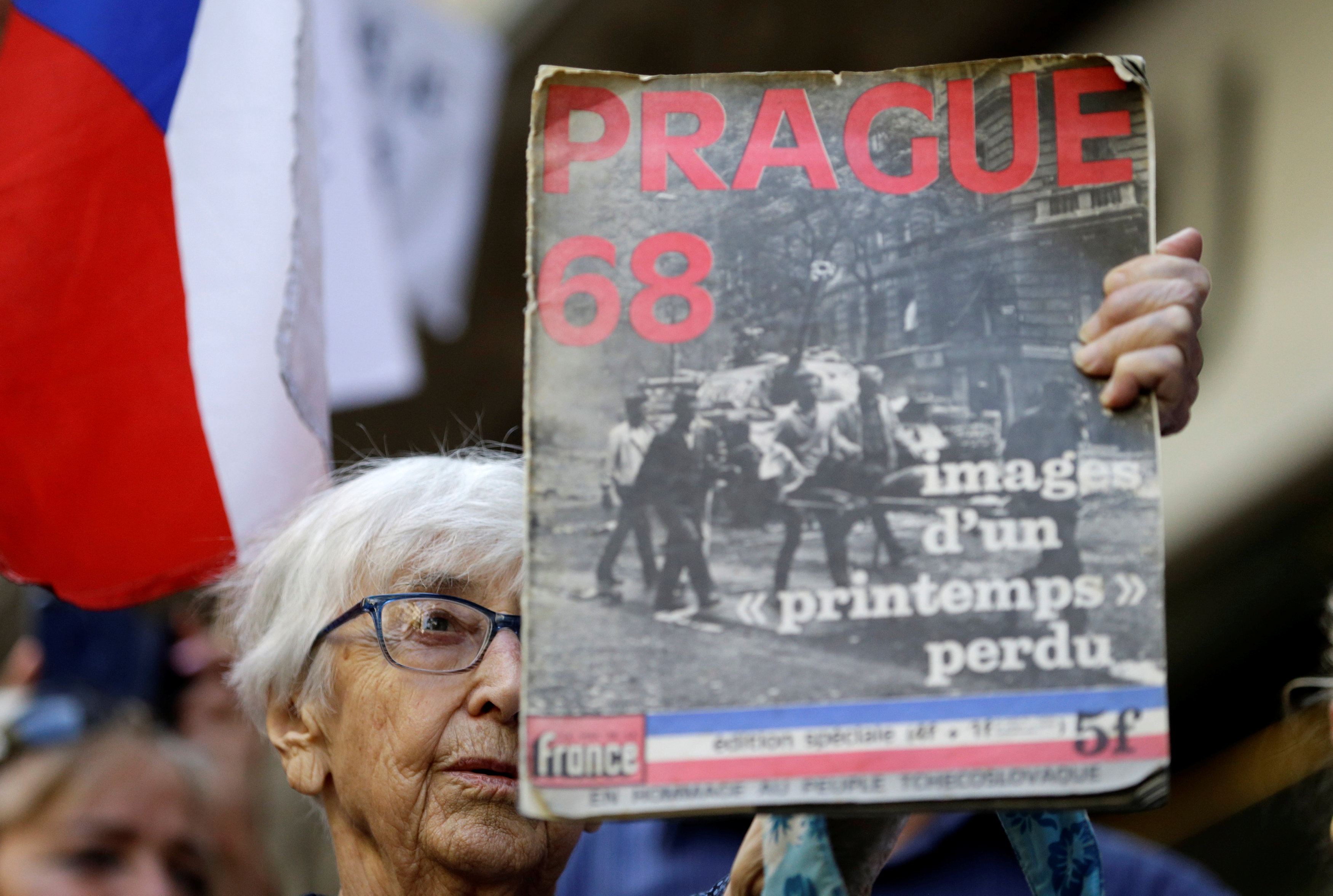 A demonstrator holds a placard as she protests.