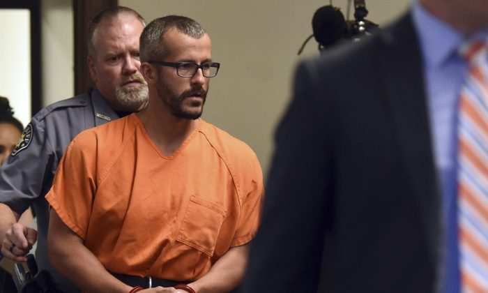 Christopher Watts is escorted into the courtroom before his bond hearing at the Weld County Courthouse in Greeley, Colo. (Joshua Polson/The Greeley Tribune via AP, Pool, file)