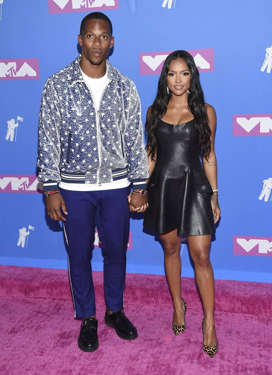 Victor Cruz (L) and Karrueche Tran.