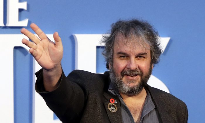 Film director Peter Jackson poses for photographers at the World premiere of the Beatles movie, in London. (AP/Kirsty Wigglesworth)