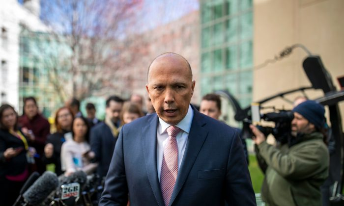 Australia's former home affairs minister, Peter Dutton, faces the media at a press conference in Canberra on Aug. 21, 2018. (Sean Davey/AFP/Getty Images)