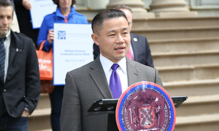 John Liu and Kenneth Cole (rear) attend the 2013 Footwear Cares Community Service Week and National Volunteer Week announcement at City Hall in New York City on April 22, 2013. (Rob Kim/Getty Images)