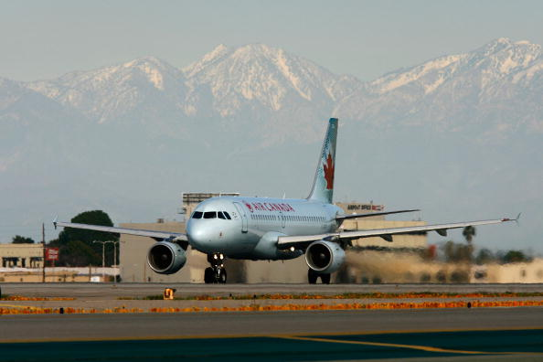 An Air Canada jet lands near where a new lighting system warning pilots of potential runway hazards is to be installed at Los Angels International Airport (LAX) on Feb. 26, 2008 in Los Angeles, California. (David McNew/Getty Images)