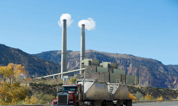 A coal truck drives by Pacificorp's 1000 megawatt coal fired power plant outside Huntington, Utah on Oct. 9, 2017. (George Frey/Getty Images)
