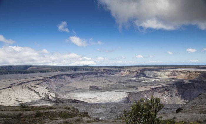 This National Park Service photo shows Halemaumau Crater, which has quadrupled in size since May, and Kilauea Caldera at Kilauea volcano's summit inside Hawaii Volcanoes National Park in Hawaii on Friday, Aug. 17, 2018. (Janice Wei/National Park Service via AP)