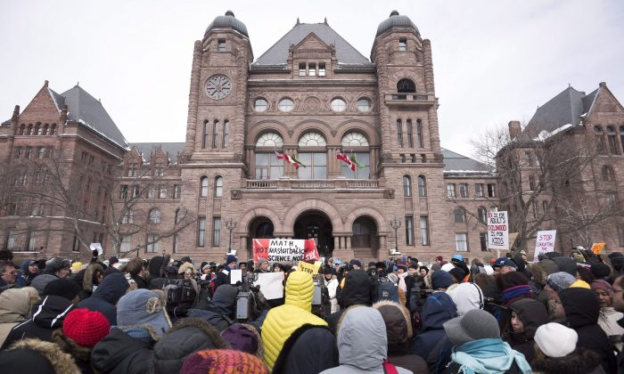 Demonstrators gather in front of Queen's Park to protest against Ontario's new sex education curriculum in Toronto on Feb. 24, 2015. (THE CANADIAN PRESS/Darren Calabrese)