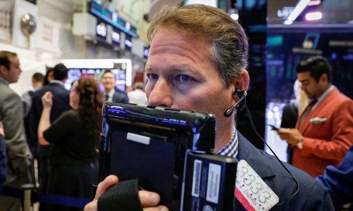 Traders work on the floor of the New York Stock Exchange in New York, U.S., Aug. 17, 2018. (Reuters/Brendan McDermid)