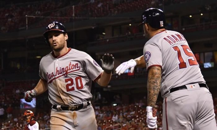 Washington Nationals second baseman Daniel Murphy celebrates with pinch hitter Matt Adams after hitting a solo home run off of St. Louis Cardinals starting pitcher Daniel Poncedeleon during the ninth inning. (Reuters/Jeff Curry)
