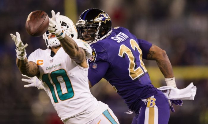 Miami Dolphins wide receiver Kenny Stills is unable to make a catch as Baltimore Ravens cornerback Jimmy Smith defends in the fourth quarter. (Patrick McDermott/USA Today Sports)