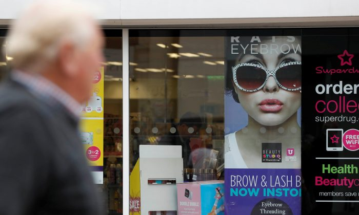 A woman walks past a branch of Superdrug in Loughborough, Britain. Aug 22, 2018. (Reuters/Darren Staples)