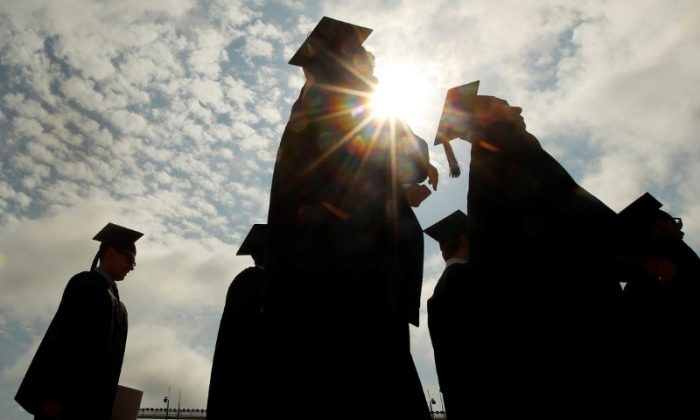 Graduating students in Boston, Mass., on May 20, 2013. (Reuters/Brian Snyder)