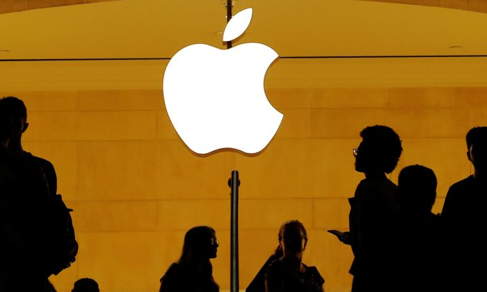 Customers walk past an Apple logo inside of an Apple store at Grand Central Station in New York on Aug. 1, 2018. (Reuters/Lucas Jackson).