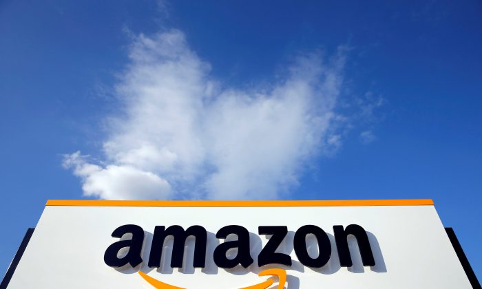 The logo of Amazon is seen at the company logistics centre in Boves, France on Aug. 8, 2018. (Reuters/Pascal Rossignol)
