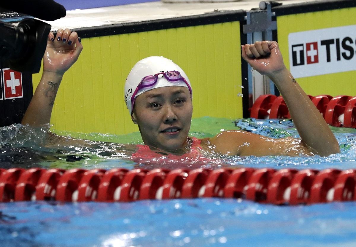 China's Liu Xiang celebrates.