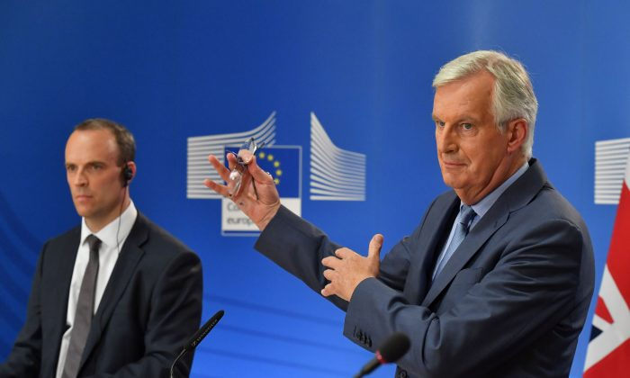 "EU chief negotiator Michel Barnier (R) and Britain's Brexit secretary Dominic Raab said that Brexit negotiations would now proceed ""continuously,"" at a joint press conference in Brussels on Aug. 21, 2018. (John Thys/AFP/Getty Images)"