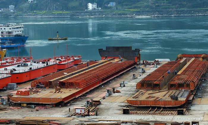 Laborers work in a shipyard in Yichang, central China's Hubei province, on March 1, 2015. (STR/AFP/Getty Images)