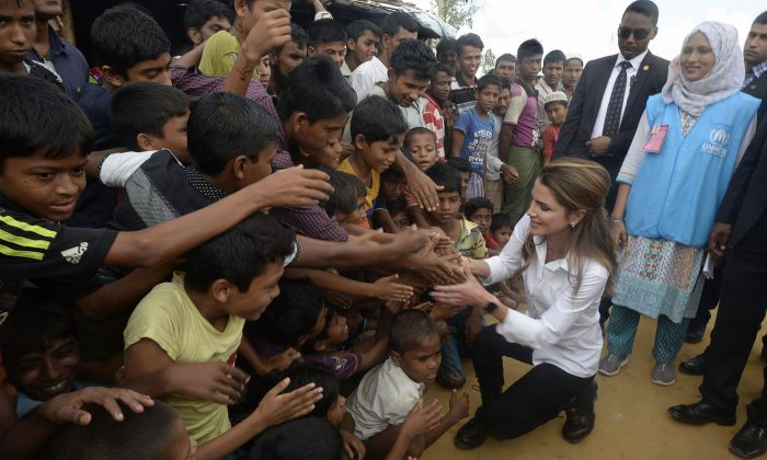 Jordan's Queen Rania shaking hands with Rohingya Muslim refugees during her visit to the Kutupalong refugee camp in Ukhia on Oct. 23, 2017. (Tauseef Mustafa/AFP/Getty Images)