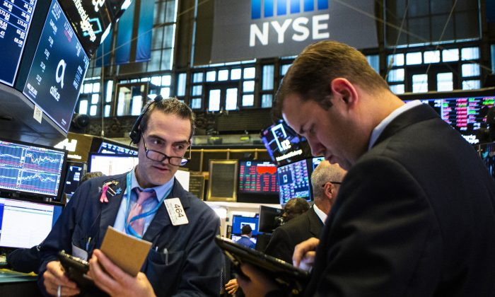 Traders work on the floor of the New York Stock Exchange ahead of the closing bell on Aug. 15, 2018. Share buybacks are now one of the biggest sources of demand for stocks. (Eduardo Munoz Alvarez/Getty Images)