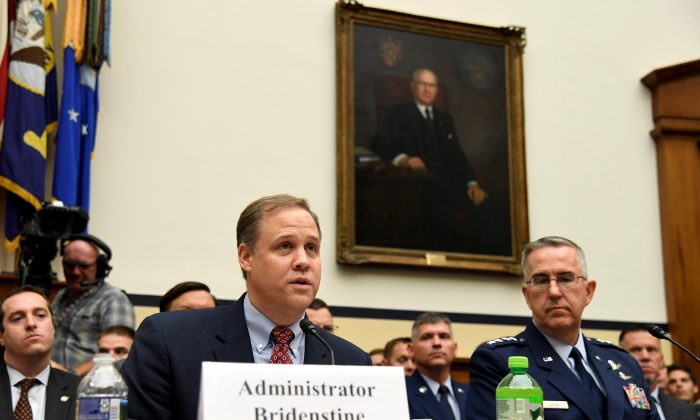 FILE PHOTO: NASA Administrator Jim Bridenstine (L) makes remarks as US Strategic Command Commander Gen. John Hyten listens during the House Armed Services Strategic Forces Subcommittee's joint hearing with the House Science, Space and Technology Committee, in Washington, U.S., June 22, 2018.  REUTERS/Mike Theiler/File Photo