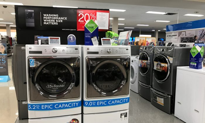 FILE PHOTO: Sears Kenmore washing machines are shown for sale inside a Sears department store in La Jolla, California, U.S., March 22, 2017.    REUTERS/Mike Blake