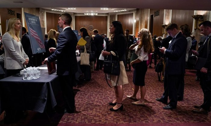 People wait in line at a stand during the Executive Branch Job Fair hosted by the Conservative Partnership Institute at the Dirksen Senate Office Building in Washington, on June 15, 2018. (Reuters/Toya Sarno Jordan)