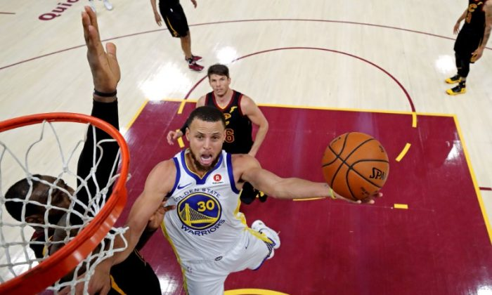 Golden State Warriors guard Stephen Curry (30) shoots the ball against Cleveland Cavaliers forward LeBron James (23) during the fourth quarter in game four of the 2018 NBA Finals. (Kyle Terada/USA Today Sports)