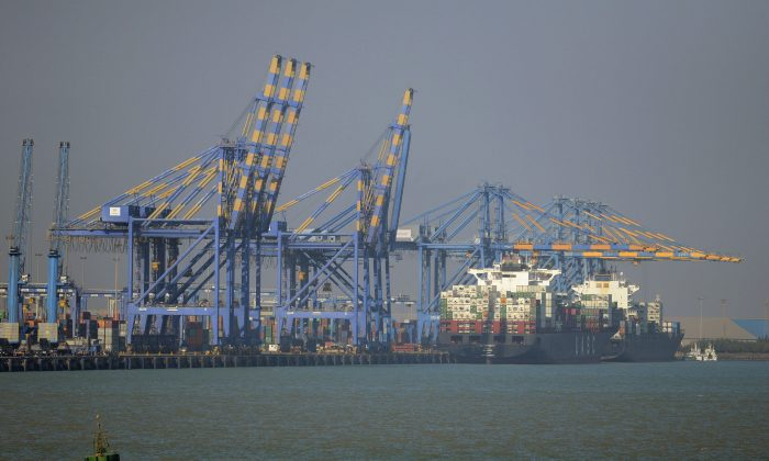 A container ship (R) docked at India's Adani Port Special Economic Zone (APSEZ) in Mundra on December 21, 2016. Arthur Wiegenfeld recommends the United States increase trade with India. (SAM PANTHAKY/AFP/Getty Images)