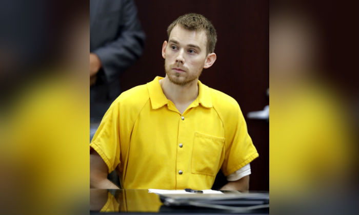 Travis Reinking appears at a hearing Wednesday, Aug. 22, 2018, in Nashville, Tenn. Reinking is charged with killing four people during a shooting at a Waffle House restaurant in Nashville in April. (AP Photo/Mark Humphrey)