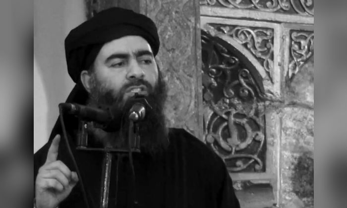 The leader of the ISIS terrorist group Abu Bakr al-Baghdadi at a mosque in Iraq on July 5, 2014. (AP Photo/extremist video)