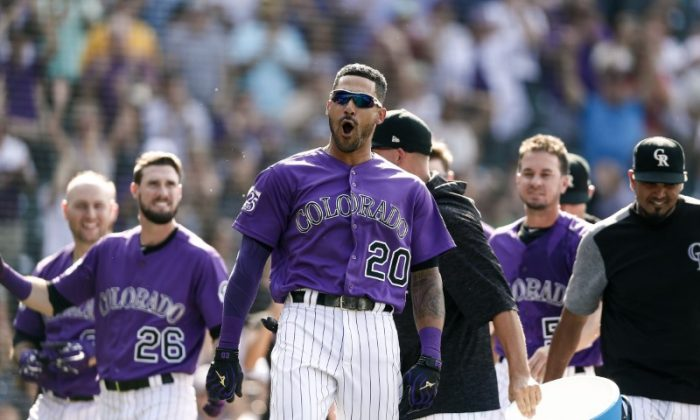 Colorado Rockies first baseman Ian Desmond (20) celebrates with teammates after hitting walk off two run home run in the ninth inning against the San Diego Padres. (Isaiah J. Downing/USA Today Sports)
