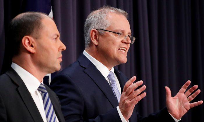 Australian Prime Minister Scott Morrison speaks next to his deputy Josh Frydenberg during a news conference in Canberra, Australia, on Aug. 24, 2018. (Reuters/David Gray)