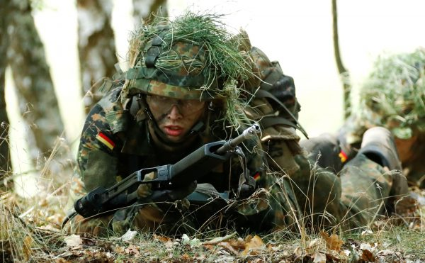 A German Bundeswehr armed forces recruit takes position