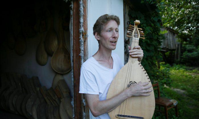 Musician Yuriy Fedynsky plays a Ukrainian folk instrument called a kobza next to his workshop in the village of Kryachkivka, Ukraine Aug. 13, 2018.  (Reuters/Valentyn Ogirenko)