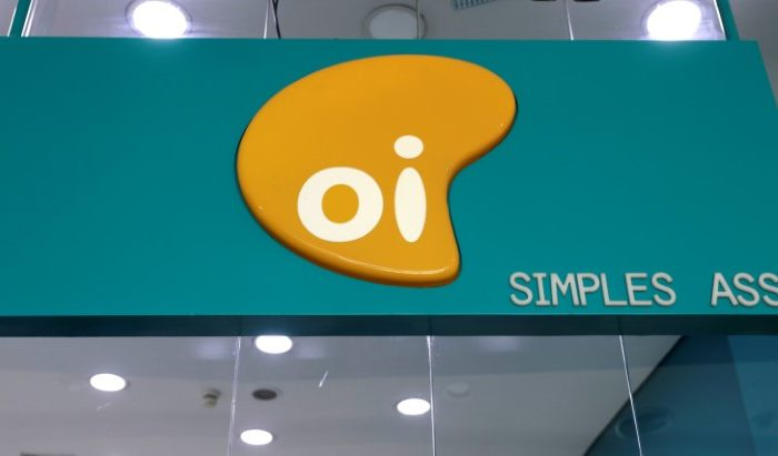 The logo of Brazilian telecoms company Oi SA is pictured inside a store in Sao Paulo, Brazil on July 18, 2018. (Reuters/Paulo Whitaker).
