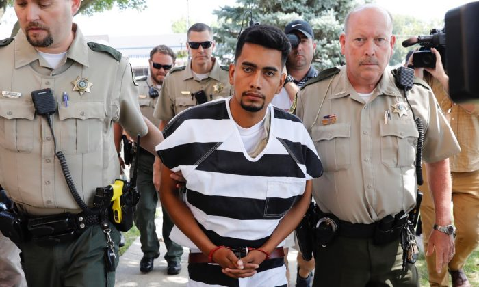 Cristhian Bahena Rivera is escorted into the Poweshiek County Courthouse for his initial court appearance in Montezuma, Iowa on Aug. 22, 2018. (Charlie Neibergall/AP Photo)
