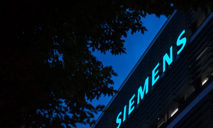 The headquarters of German engineering conglomerate Siemens AG stands at twilight on Aug. 23, 2018 in Munich, Germany.(Lennart Preiss/Getty Images)