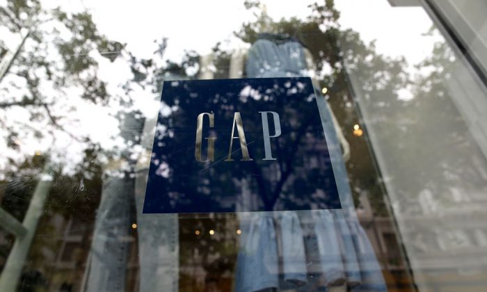 The Gap logo is displayed on a window at a Gap store in San Francisco, Calif., on May 25, 2018. (Justin Sullivan/Getty Images)