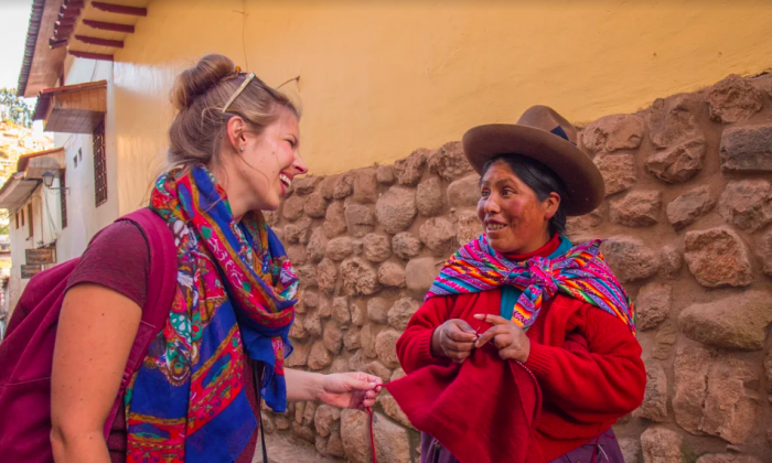A traveler meets a local in Cuzco, Peru. (Courtesy of Intrepid Group)