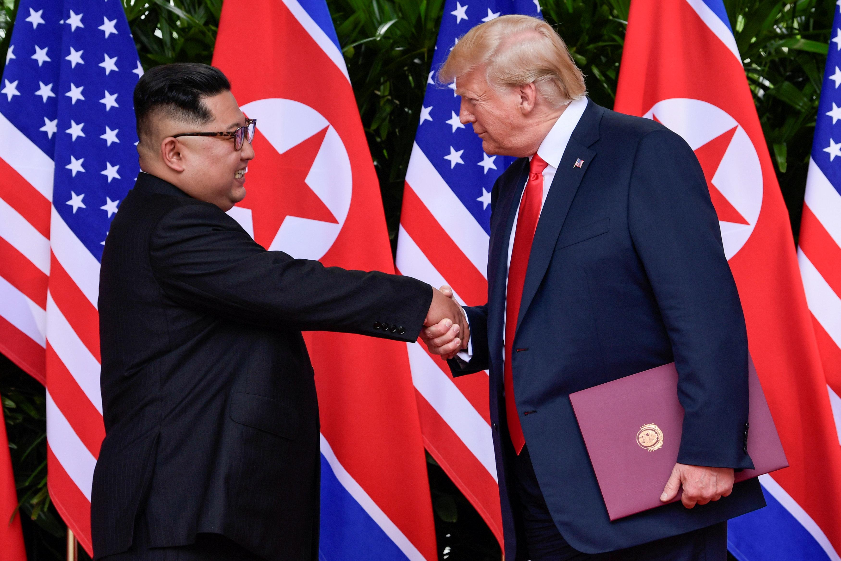 Trump and Kim shake hands at Singapore summit